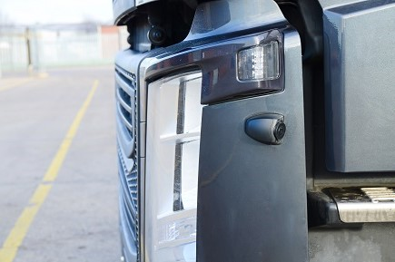Image showing a near side camera installed onto a truck. The camera helps eliminate the blind spot that a driver has in their mirrors