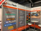 The HaulTech stand at the 2019 Tip-Ex show highlighting logos of the companies they work with
