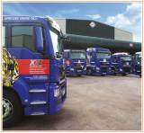 Fuchs Lubricants' blue vehicles outside of their warehouse