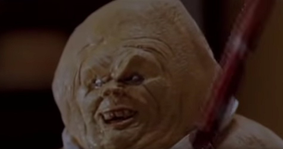 A screenshot from the 2006 horror-comedy film Gingerdead Man. It shows a gingerbread man with a ridiculous looking evil face.