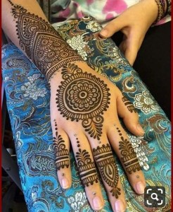She is Rukash,a very good henna artist and a makeup artist, 1