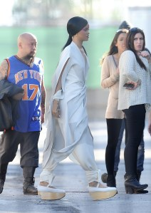 Rihanna on set of Princess of China wearing Adam Selman jumpsuit