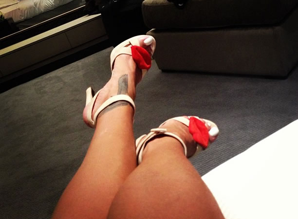 Rihanna in Rupert Sanderson Latifa lips sandals
