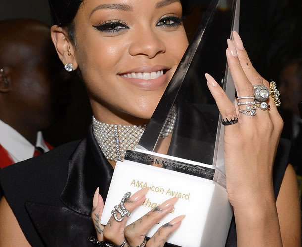 Rihanna wearing Sally Hansen Complete Manicure polish in Almost Almond