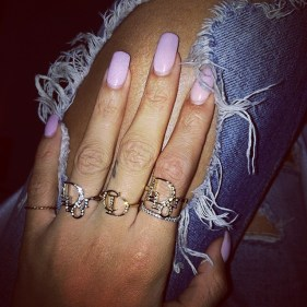 Rihanna wearing Dior rings