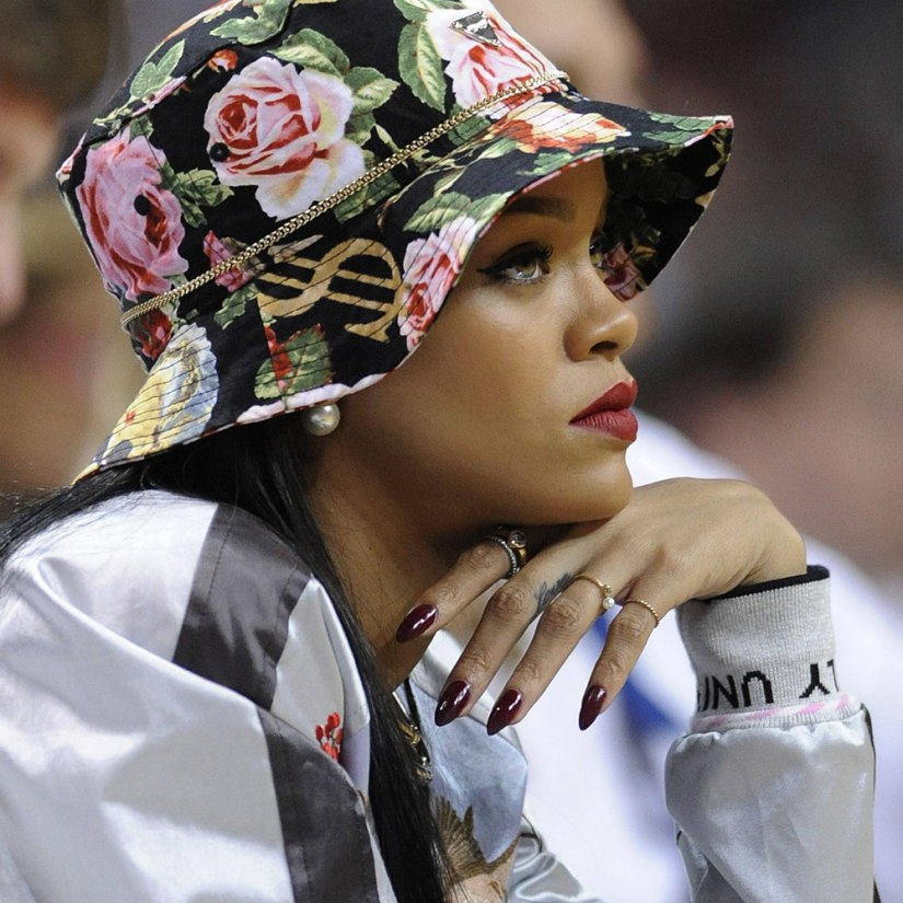 Rihanna wearing Gelish in Stand Out and OPI Malaga Wine gel nail polish