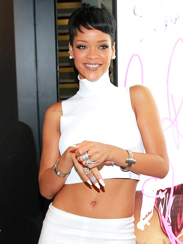 Rihanna in Hong Kong wearing Lynn Ban rings