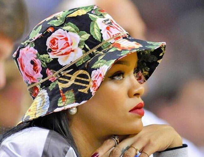 Rihanna wearing a floral bucket hat by Joyrich