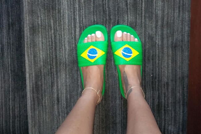1f54aee7cbc39f Rihanna wearing adidas Originals Adilette Brazil flag slides. Rihanna is  definitely enjoying the 2014 World Cup in Brazil. If you ve been watching  along