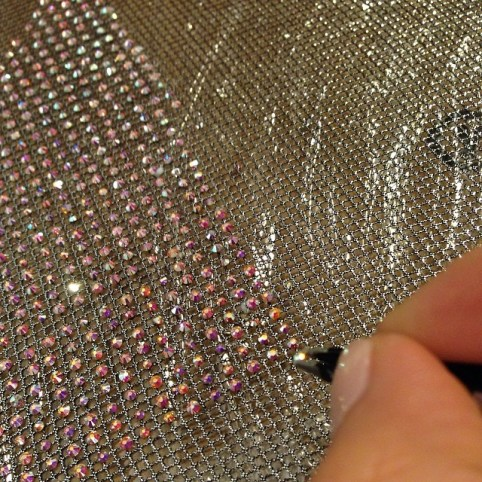 A member of Adam Selman's team applied every single Swarovski crystal to Rihanna's dress, scarf and gloves