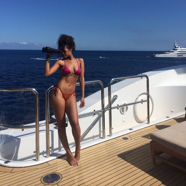 Rihanna wearing Charlie by Matthew Zink custom crystal Adriana pink and orange bikini