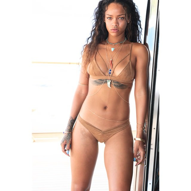Rihanna in Kai Lani brown suede bikini and Jacquie Aiche lapis bodychain, turquoise necklace and lapis cuffs
