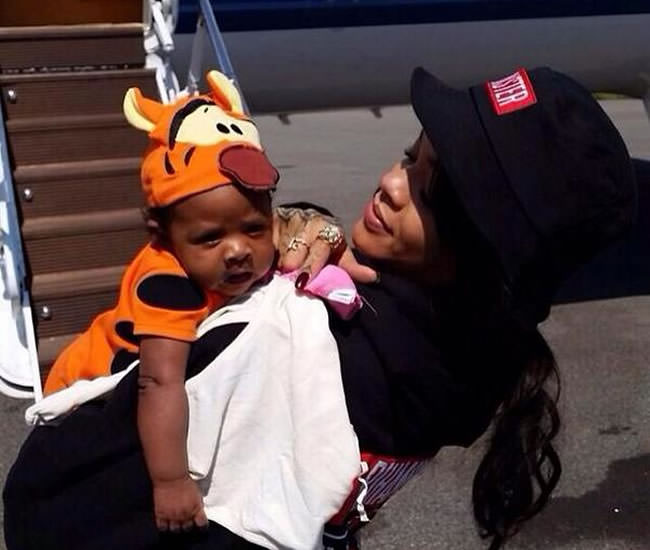 Rihanna in Trapstar x The Monster Tour bucket hat and pullover hooded sweatshirt