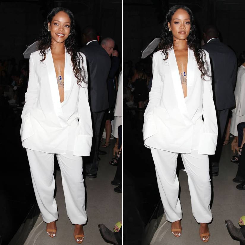 Rihanna at Edun Spring/Summer 2015 fashion show wearing Edun white wrap jacket and pants, Manolo Blahnik Chaos ankle-strap sandals, Jacquie Aiche outward trinity body chain, Ana Khouri pearl ring, Lynn Ban rings