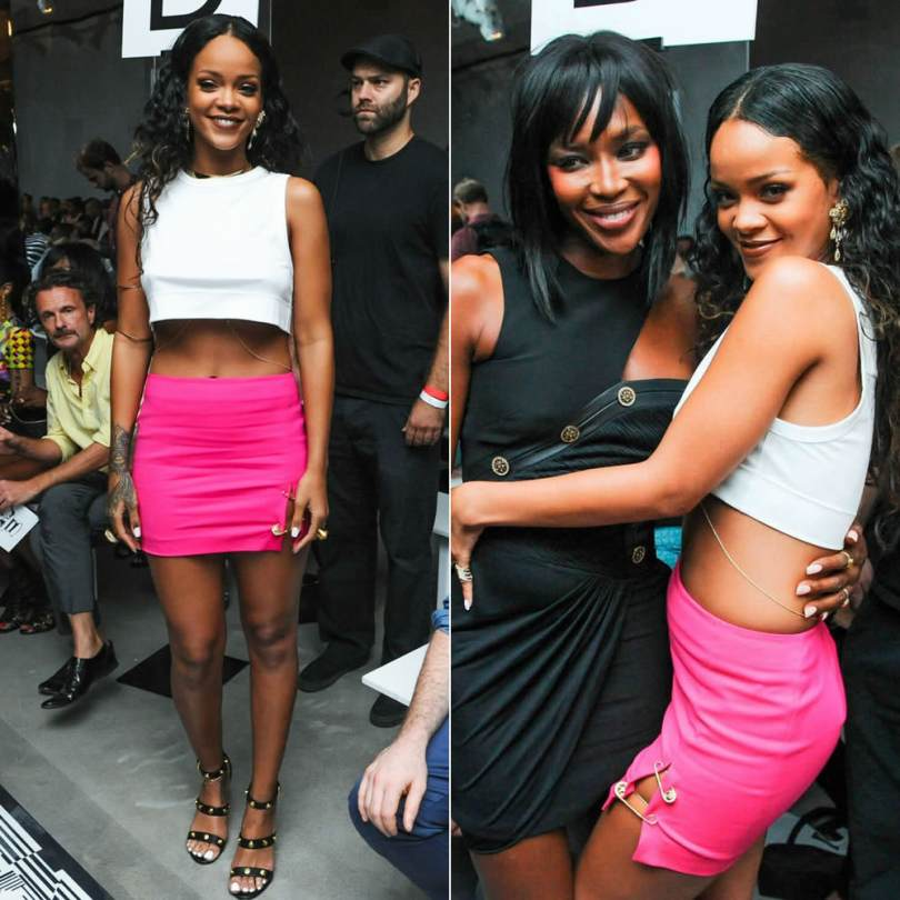 Rihanna at Versus Versace Spring/Summer 2015 fashion show wearing Versus pink skirt with safety pins, Versace Medusa black studded sandals, Versace Medusa gold rings and crystal earrings, Jennifer Fisher flat ribbon choker and square armbands, Lynn Ban gold chevron rings