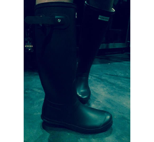 Rihanna wearing Hunter Original tall wellington rain boots
