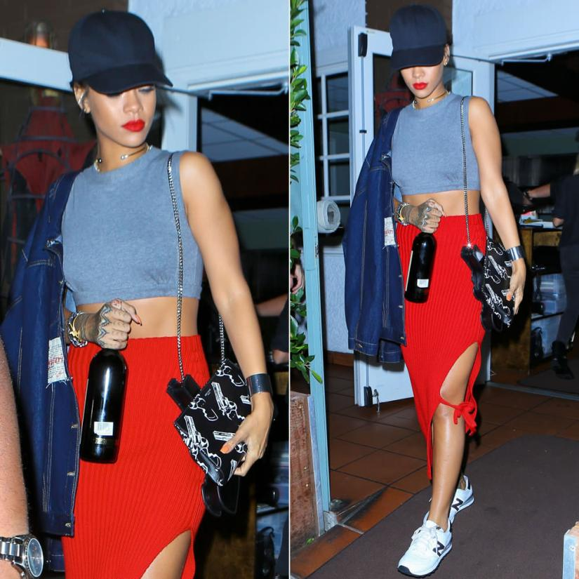 Rihanna wearing Martine Rose oversized denim jacket, Givenchy black baseball snapback cap, Norma Kamali Sweats grey midriff sleevless crop top, New Balance 574 sneakers, Saint Laurent Bo gun purse and gun print clutch, Nektar de Stagni pearl choker, Celine silver edge cuff