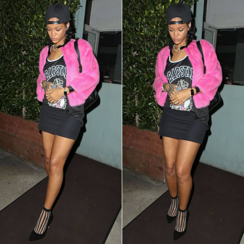 Rihanna wearing Trapstar A Basic Bitch Nightmare tank top, Manolo Blahnik BB black suede pumps, Inez and Vinoodh pearl necklace, Nektar de Stagni pearl choker, Jennifer Fisher ID bracelet, Celine silver edge cuff, Reece Hudson Siren leather backpack, Givenchy black baseball cap