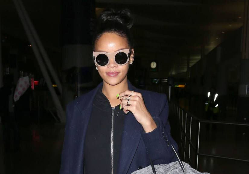 Rihanna in Stella McCartney cat eye sunglasses, Sybarite saftey pin ring, Annoushka Frost earrings