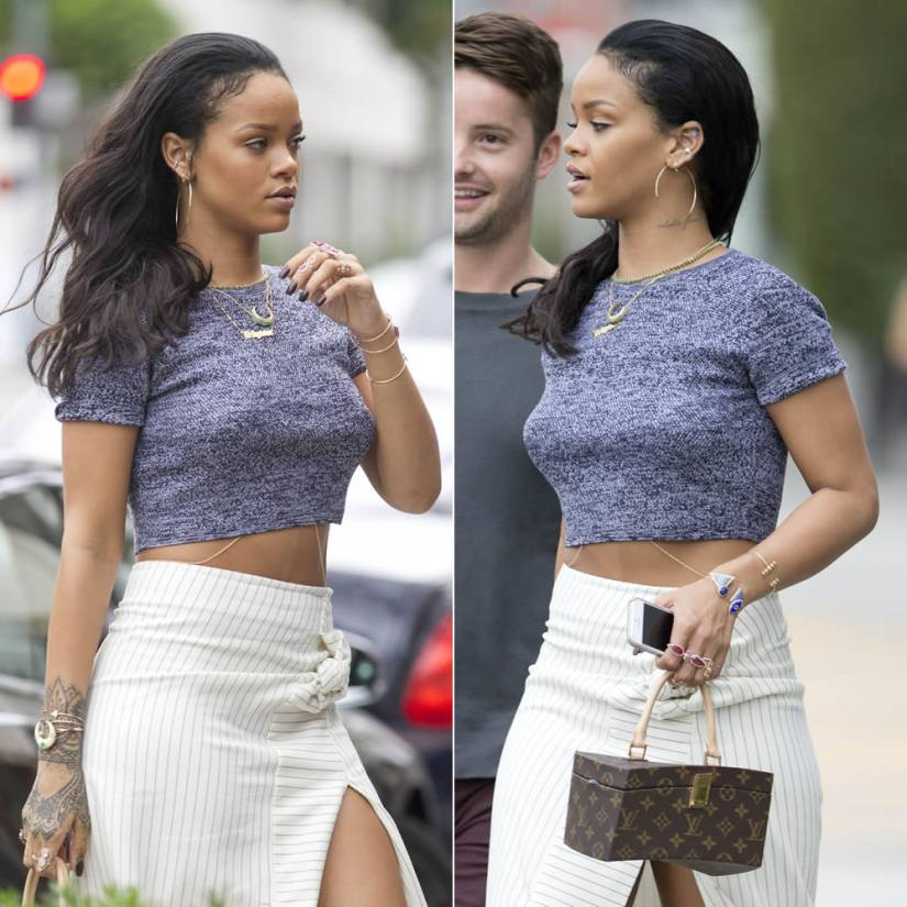 Rihanna wearing alice + oliva Solange grey herringbone crop top, J.W.Anderson pinstriped asymmetrical skirt, Louis Vuitton by Frank Gehry Twisted Box bag, Jacquie Aiche diamond hoop earrings, emerald necklaces, gemstone cuffs and rings, Sabine G prospero ring