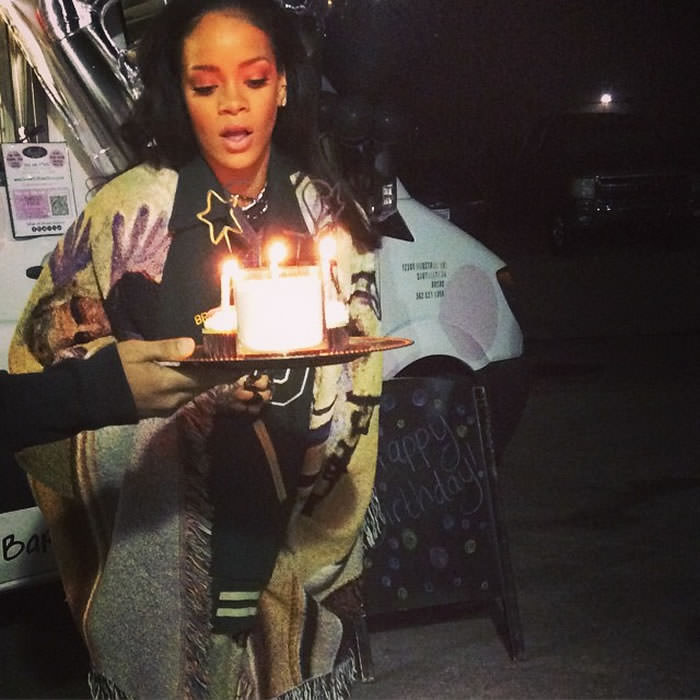 Rihanna wearing Bless varsity jacket fringed poncho