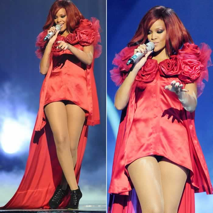 549f6ee21db6 Rihanna performing at the 2011 Brit Awards in a custom Giles Deacon red  dress