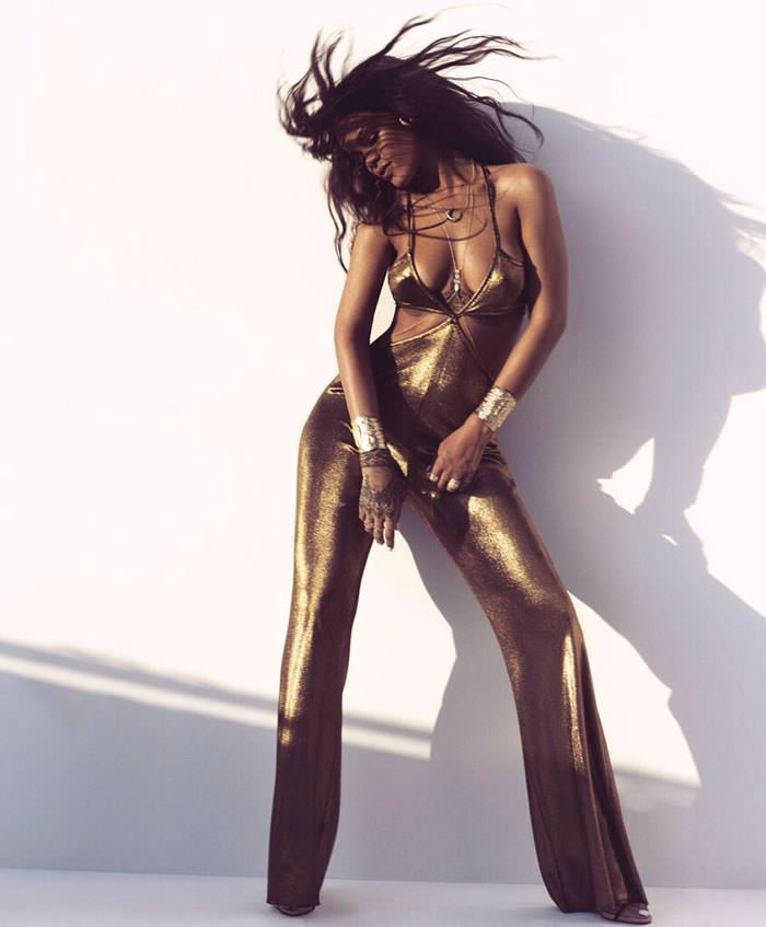 Rihanna wearing a gold Balmain jumpsuit in Harper's Bazaar March 2015 issue