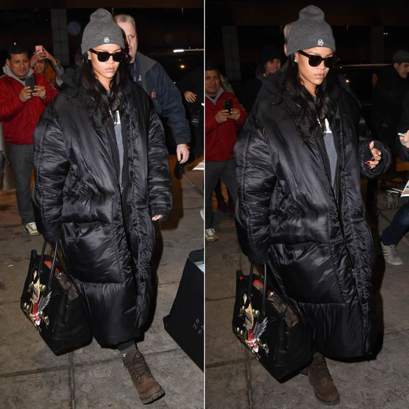 Rihanna in Superbia beanie hat, Jessica Walsh black puffer coat, Ralph Lauren embroidered Soft Ricky 40 handbagt, Timberland chocolate boots, Celine sunglasses