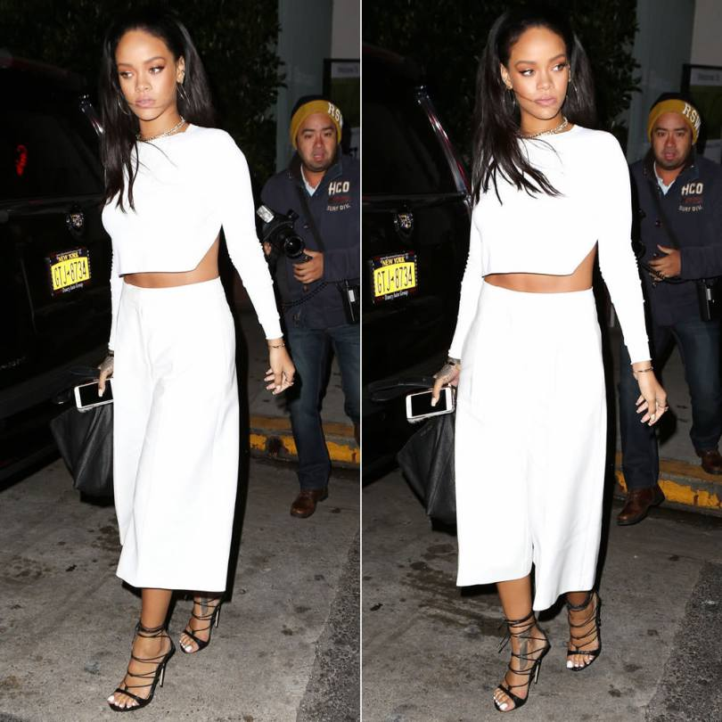 Rihanna wearing Stella McCartney white crop top and Oliver culottes, DSquared2 Pre-Fall 2015 python ankle-wrap sandals, Givenchy large pyramid pouch handbag