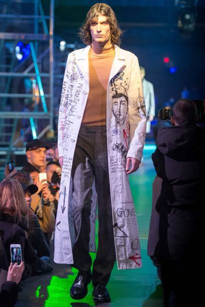 Raf Simons Fall 2015 white graffiti-covered coat as seen on Rihanna