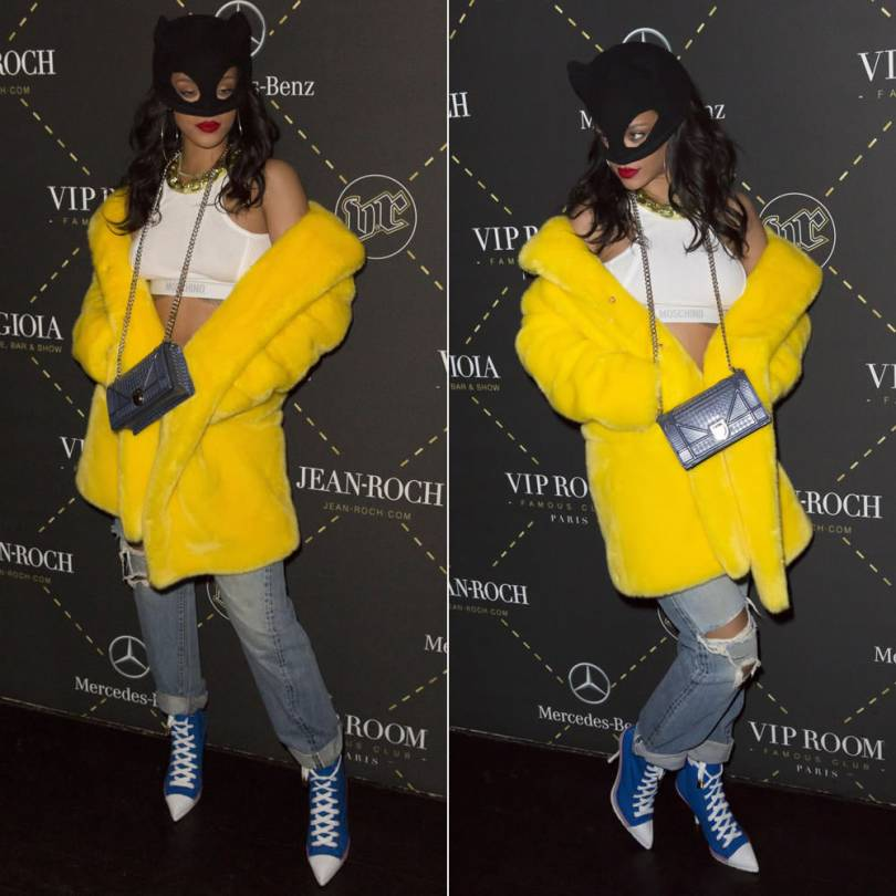 Rihanna wearing Moschino Fall 2015 yellow fur coat, white bra top and blue lace-up boots, Silver Spoon Attire cashmere kitty ear beanie mask, Dior Diorama clutch, DYLANLEX silver rings