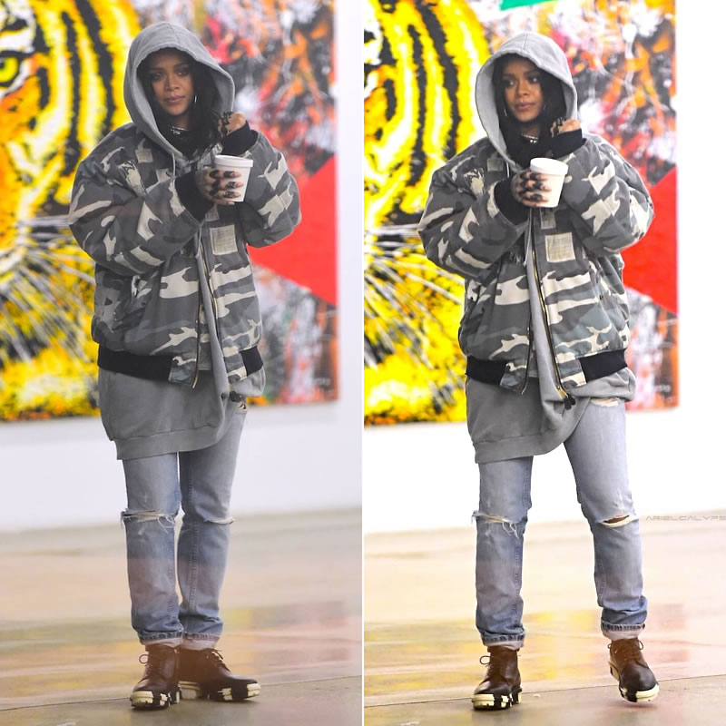Rihanna wearing Raf Simons autumn/winter 2001 camo bomber jacket, Raf Simons Spring 2004 hoodie, vintage Helmut Lang jeans, Balenciaga white and black Unit ankle boots, Lynn Ban black rhodium and black diamond crest and chevron rings