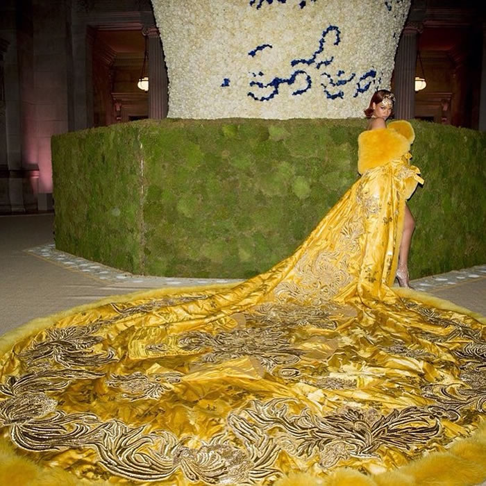 Rihanna in Guo Pei Couture yellow cape at the Met Gala 2015