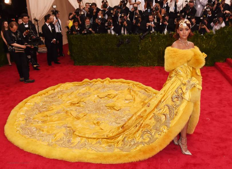 Rihanna at 2015 Costume Institute Met Gala in Guo Pei 2010 couture yellow fur coat