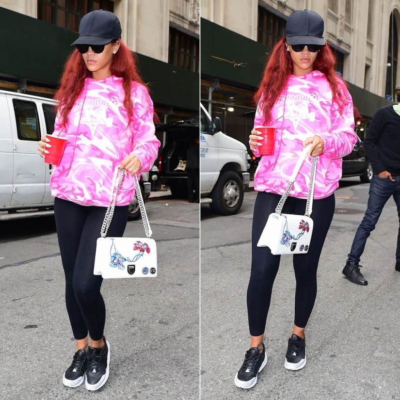 Rihanna wearing Thrasher skategoat pink camo hoodie, Puma R698 Trinomic sneakers in snow splatter, Dior white quilted embroidered Diorama handbag