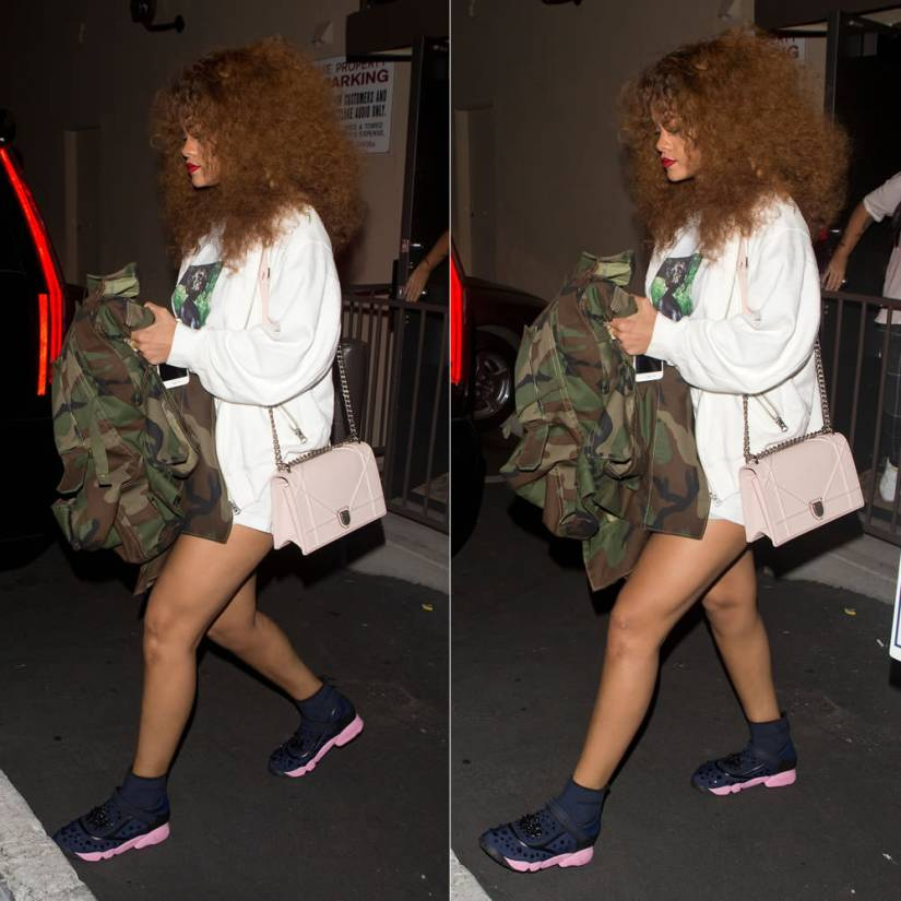 Rihanna in Richardson Magazine x Richard Prince A7 t-shirt, Matthew Dolan oversized camo jacket, Dior Fusion sneakers and Diorama handbag