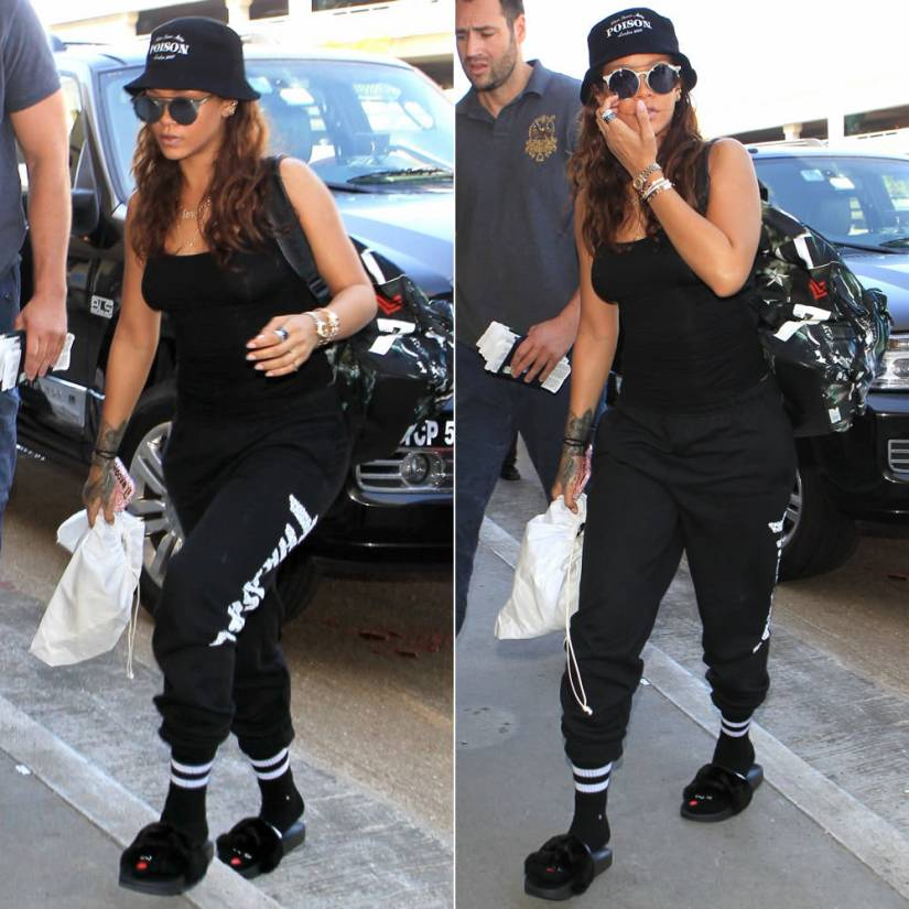 Rihanna in Silver Spoon Attire poison bucket hat, Sunday Somewhere Matahari sunglasses, Givenchy airplane print backpack, Thrasher skull sweatpants, Rihanna x Stance bitch what socks, Puma by Rihanna fur slide sandals
