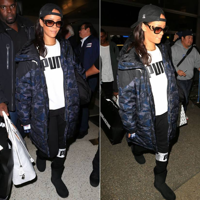 Rihanna Puma Bape camo coat, 40oz Van studios hat, Prada square baroque sunglasses, Puma taping sweatshirt, Puma icon sweatpants, UGG bailey button boots, Goyard Vendome PM white handbag