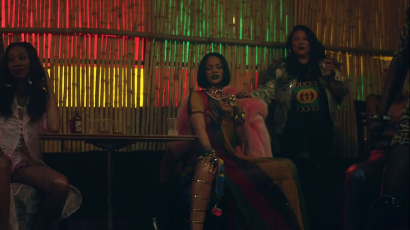 Rihanna in Work music video wearing Tommy Hilfiger Spring 2016 rasta crochet dress, Giuseppe Zanotti gold strappy gladiator sandals, Creepyyeha pink Tall Tahliah choker