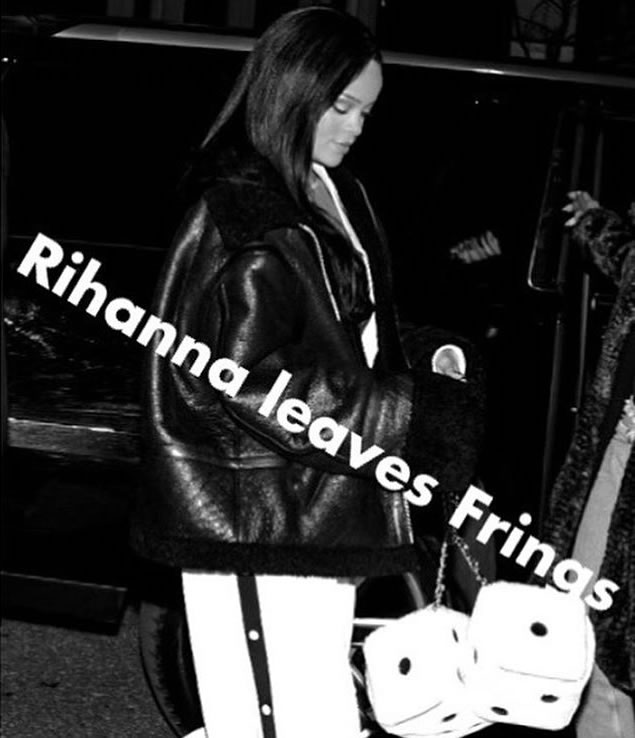 Rihanna Vetements black shearling leather jacket, Fenty x Puma Fall 2016 white track pants, Moschino dice-shaped handbag