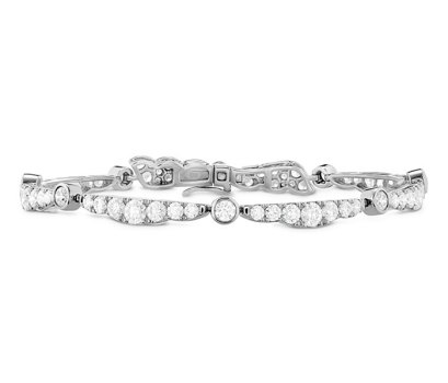 Hearts On Fire 18k white gold and white diamond Lorelei ribbon bracelet as seen on Rihanna