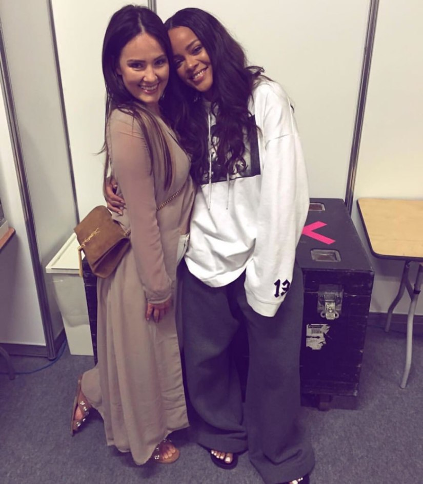 Rihanna Fenty x Puma Fall 2016 graphic hoodie, grey trousers, black fur slides