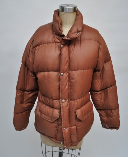 The North Face vintage brown puffer jacket from Goodbye Heart Woman as seen on Rihanna