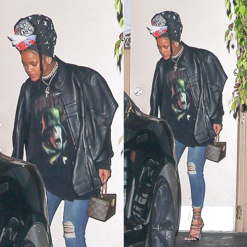 Rihanna Givenchy army skull print sweatshirt, Vetements black moto jacket, J Brand 835 mid rise skinny capri jeans, Dsquared2 Riri sandals, Louis Vuitton Twisted Box handbag