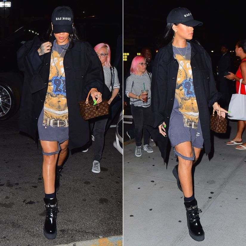 Rihanna Mathew Adams Dolan black oversized jacket, Tupac vintage t-shirt, Fenty x Puma wedge boots, Bathory hat, Louis Vuitton Twisted Box handbag
