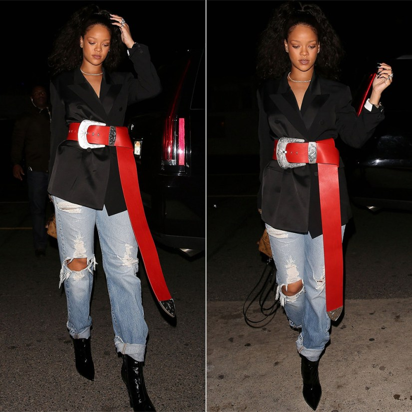 Rihanna Maison Margiela red western belt and black double breasted blazer, Balenciaga black patent broken heel ankle boots, Louis Vuitton Palm Springs Mini backpack, Jacquie Aiche cameo rings