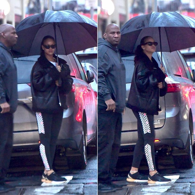 Rihanna Puma Ignite Dual Gold sneakers, Vetements black leather shearling jacket, Ray-Ban Cabellero sunglasses
