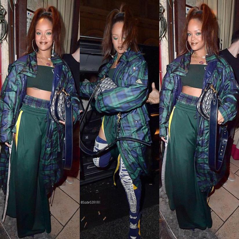 Rihanna Fenty Puma plaid parka, crop top, green track pants, thigh-high heeled boots, Lynn Ban smoking blunt necklace, Dior handbag