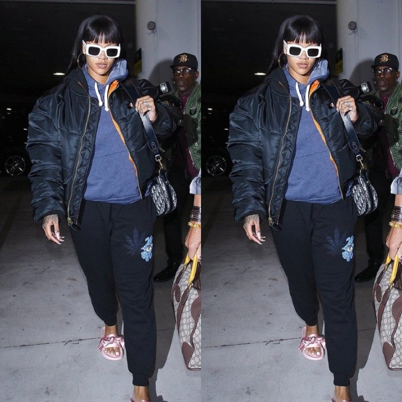 Rihanna Jacquie Aiche sweet leaf joggers, Vetements x Alpha Industries reversible black quilted bomber jacket, Raen flatscreen white sunglasse, Fenty x Puma pink bow satin slides