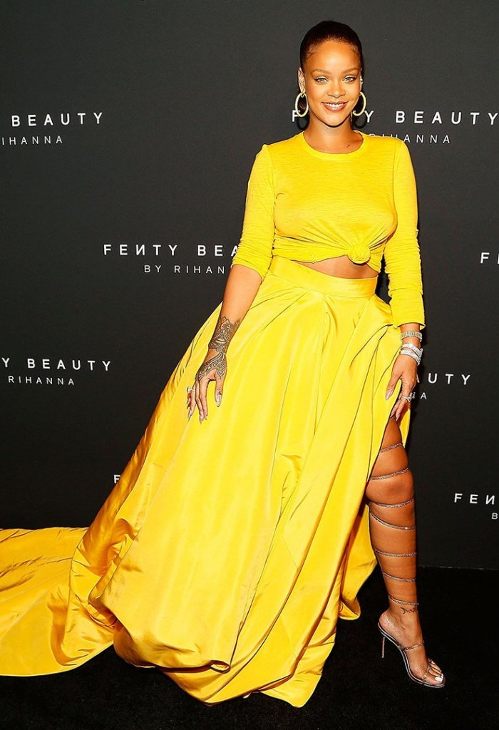 Rihanna Fenty Beauty Launch yellow Oscar de la Renta dress, gold Rene Caovilla sandals, Jacob and Co hoop earrings, Etho Maria diamond bracelet, Chopard rings, Anita Ko diamond ear cuff